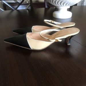 CHANEL beige and black leather mules